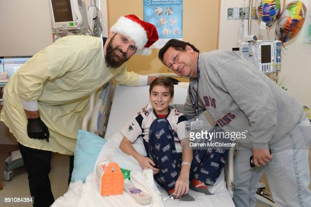 New England Patriot alumni Sebastian Vollmer visits with Mike and Dad at Boston Children's Hospital December 12 2017 in Boston Massachusetts