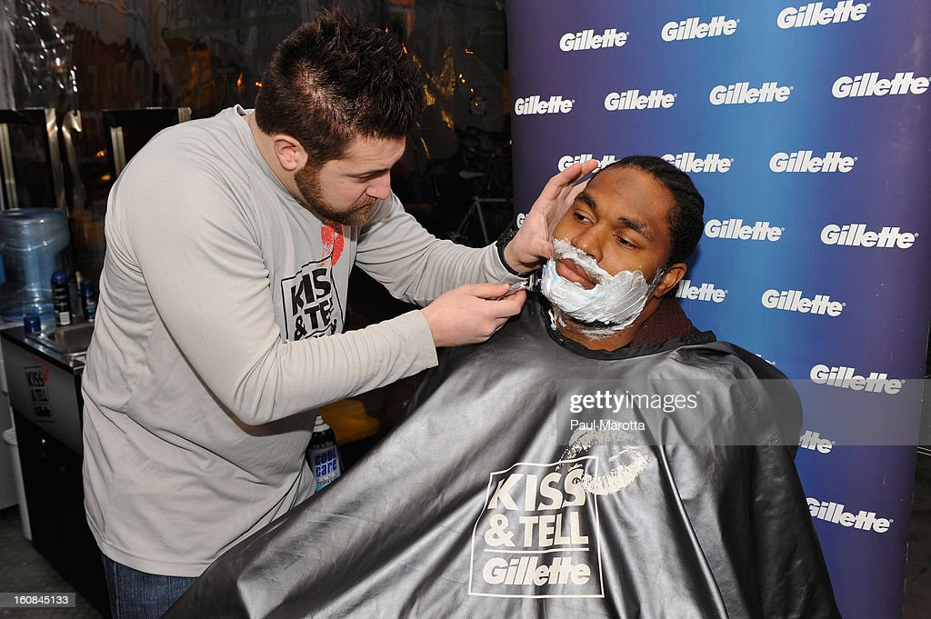New England Patriot Jerod Mayo gets the sparks flying at Gillette's Kiss & Tell Live National Experiment in Boston by asking women which kiss is best: a kiss with stubble or smooth shaven skin at Gillette's Kiss & Tell Live National Experiment at Boylston Plaza - Prudential Center on February 6, 2013 in Boston, Massachusetts.