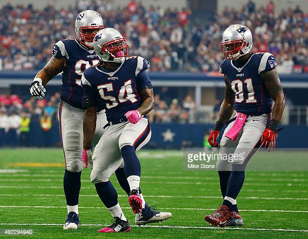 New England Patriots Alan Branch of the New England Patriots Dont'a Hightower of the New England Patriots and Jamie Collins of the New England...