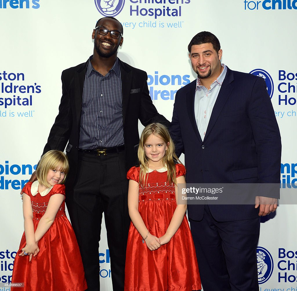 New England Patriots' <a gi-track='captionPersonalityLinkClicked' href=/galleries/search?phrase=Chandler+Jones&family=editorial&specificpeople=7181843 ng-click='$event.stopPropagation()'>Chandler Jones</a> and <a gi-track='captionPersonalityLinkClicked' href=/galleries/search?phrase=Joe+Vellano&family=editorial&specificpeople=7256652 ng-click='$event.stopPropagation()'>Joe Vellano</a> attend Champions for Children's with Annika (L) and Avery at Seaport World Trade Center on December 3, 2013 in Boston, Massachusetts.