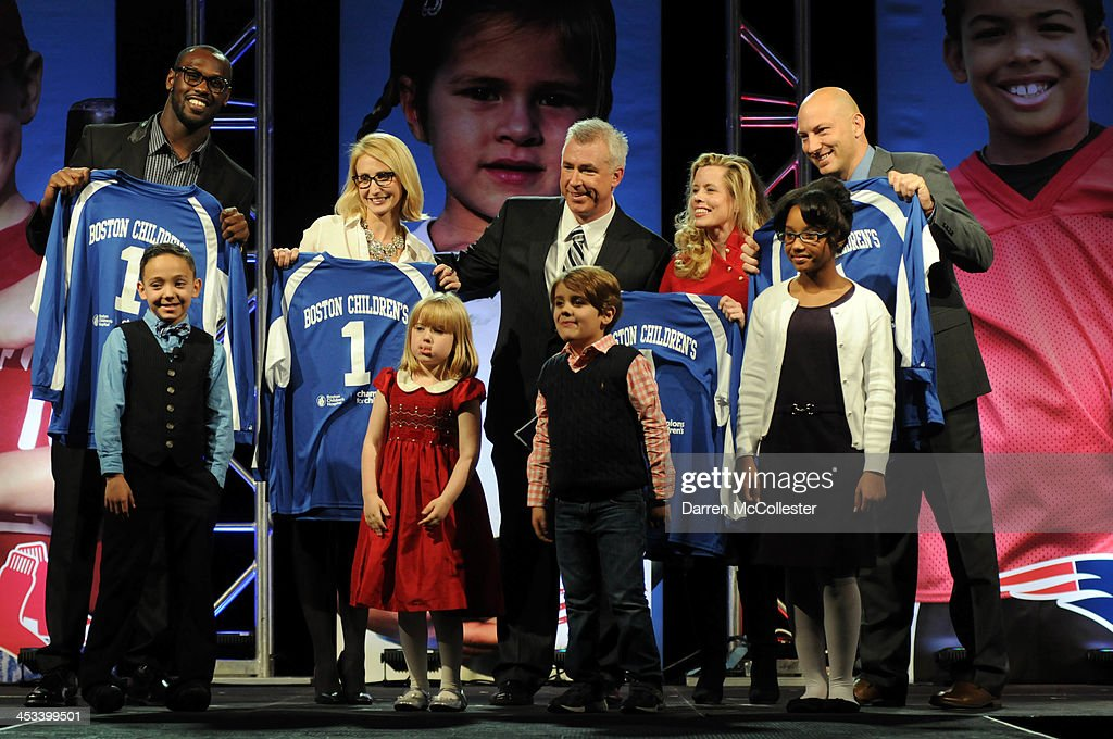 New England Patriots' <a gi-track='captionPersonalityLinkClicked' href=/galleries/search?phrase=Chandler+Jones&family=editorial&specificpeople=7181843 ng-click='$event.stopPropagation()'>Chandler Jones</a>, Dr. Christina Vanderpluym, emcee Dan Roche, Jessica McAllister and New England Revolution's <a gi-track='captionPersonalityLinkClicked' href=/galleries/search?phrase=Matt+Reis&family=editorial&specificpeople=586200 ng-click='$event.stopPropagation()'>Matt Reis</a> attend Champions for Children's with Drystan, Annika, Elliot, Teyjhana at Seaport World Trade Center on December 3, 2013 in Boston, Massachusetts.