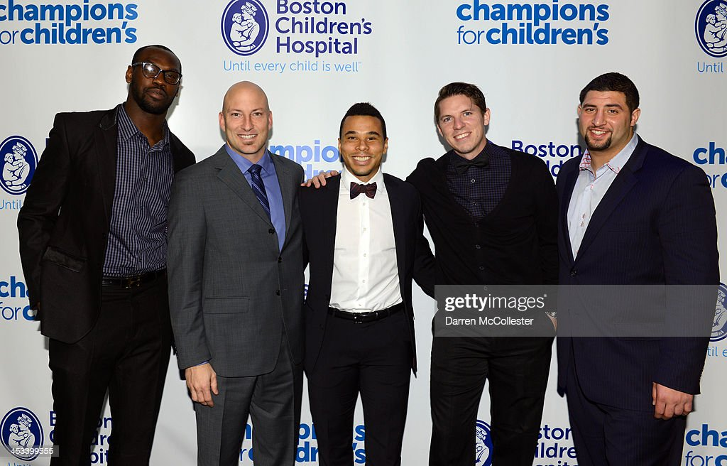 New England Patriots <a gi-track='captionPersonalityLinkClicked' href=/galleries/search?phrase=Chandler+Jones&family=editorial&specificpeople=7181843 ng-click='$event.stopPropagation()'>Chandler Jones</a>, New England Revolution players <a gi-track='captionPersonalityLinkClicked' href=/galleries/search?phrase=Matt+Reis&family=editorial&specificpeople=586200 ng-click='$event.stopPropagation()'>Matt Reis</a>, <a gi-track='captionPersonalityLinkClicked' href=/galleries/search?phrase=Charlie+Davies&family=editorial&specificpeople=2297598 ng-click='$event.stopPropagation()'>Charlie Davies</a>, Bobby Shuttleworth and New England Patriots <a gi-track='captionPersonalityLinkClicked' href=/galleries/search?phrase=Joe+Vellano&family=editorial&specificpeople=7256652 ng-click='$event.stopPropagation()'>Joe Vellano</a> attend Champions for Children's at Seaport World Trade Center on December 3, 2013 in Boston, Massachusetts.