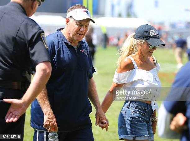 New England Patriots Coach Bill Belichick and his girlfriend Linda Holliday walk off the field at the end of training camp at the Gillette Stadium...