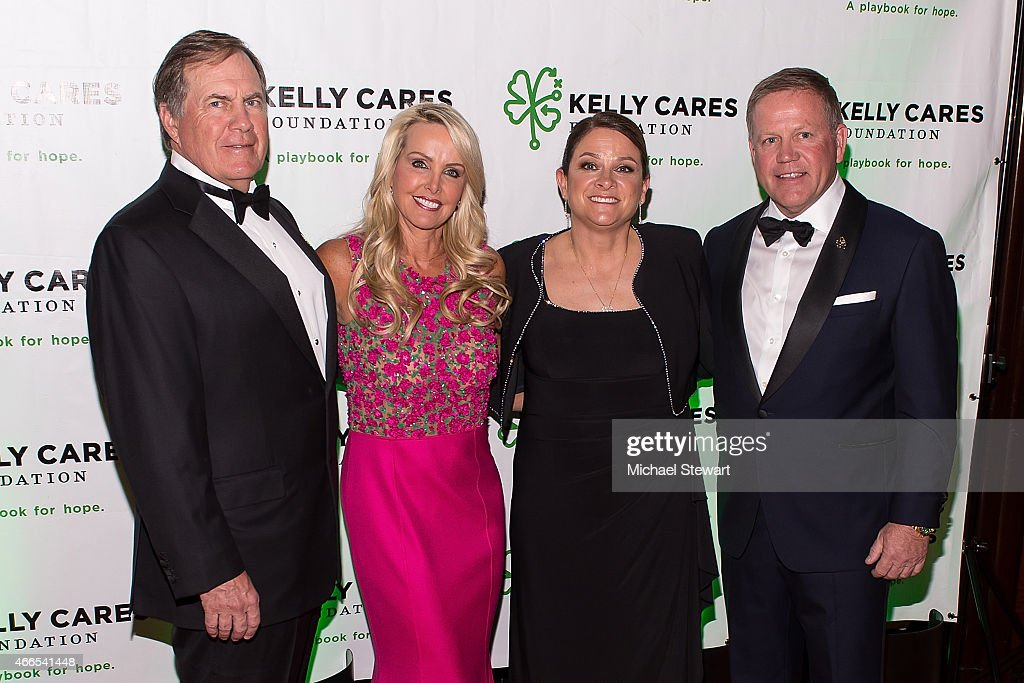 New England Patriots coach <a gi-track='captionPersonalityLinkClicked' href=/galleries/search?phrase=Bill+Belichick&family=editorial&specificpeople=201822 ng-click='$event.stopPropagation()'>Bill Belichick</a>, Linda Holliday, Paqui Kelly and University of Notre Dame football coach <a gi-track='captionPersonalityLinkClicked' href=/galleries/search?phrase=Brian+Kelly+-+Allenatore+di+football+americano&family=editorial&specificpeople=11611987 ng-click='$event.stopPropagation()'>Brian Kelly</a> attend the 5th Annual Irish Eyes Gala at JW Marriott Essex House on March 16, 2015 in New York City.