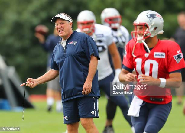 New England Patriots Coach Bill Belichick smiles as he chats during training camp warmups at the Gillette Stadium practice field in Foxborough Mass...