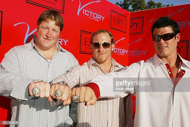 New England Patriot's Dan Koppen Larry Izzo and Lonie Paxton show their Super Bowl rings at 'Fight for Victory' the 13th Annual Espy PreParty hosted...