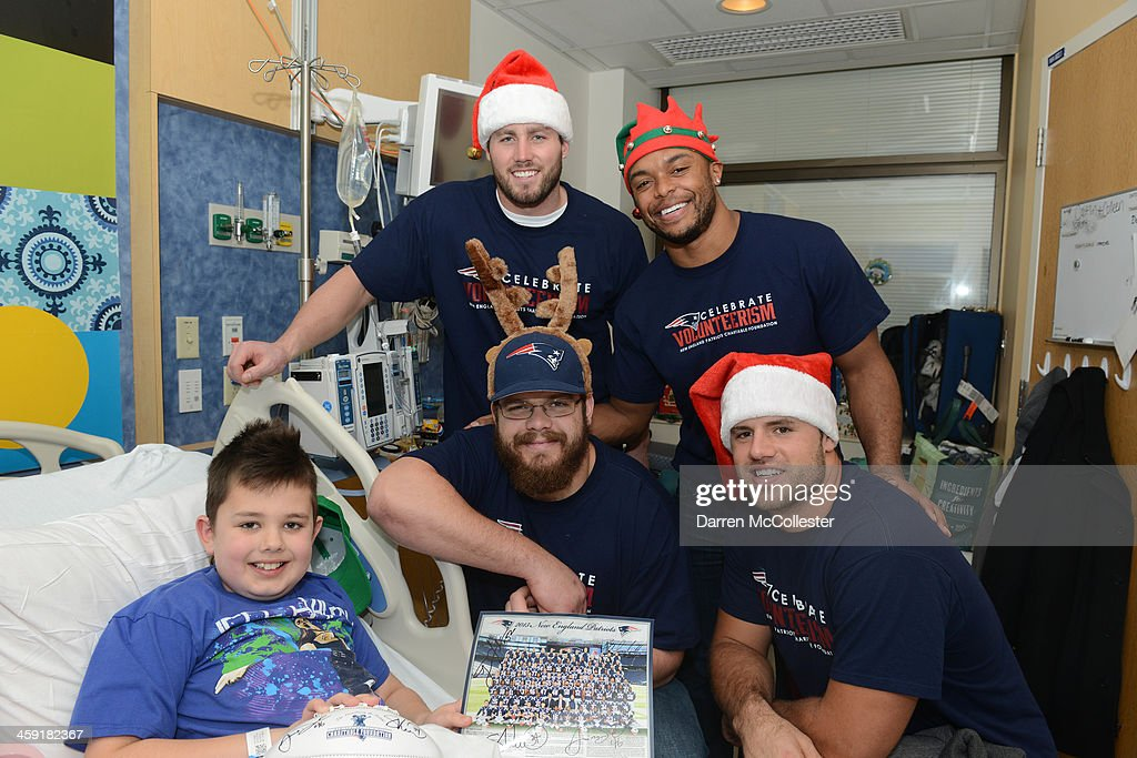 New England Patriots Dane Fletcher Shane Vereen Ryan Wendell and James Develin visit with Ethyn at Boston Children's Hospital on December 23 2013 in...