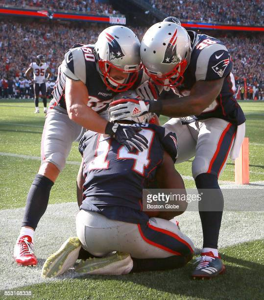 New England Patriots Danny Amendola left and James White right congratulate teammate Brandin Cooks after he made a touchdown late in the fourth...