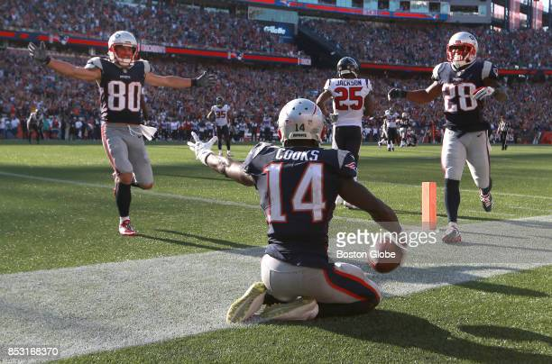 New England Patriots Danny Amendola left and James White right run to teammate Brandin Cooks after he made a touchdown late in the fourth quarter of...