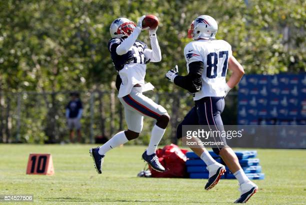 New England Patriots defensive back Devin McCourty picks off a pass over New England Patriots tight end Rob Gronkowski during New England Patriots...