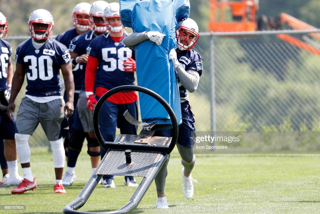 New England Patriots defensive back Nate Ebner (43) hits the sled during New England Patriots OTA on June 13, 2017, at the Patriots Practice Facility in Foxborough, Massachusetts.
