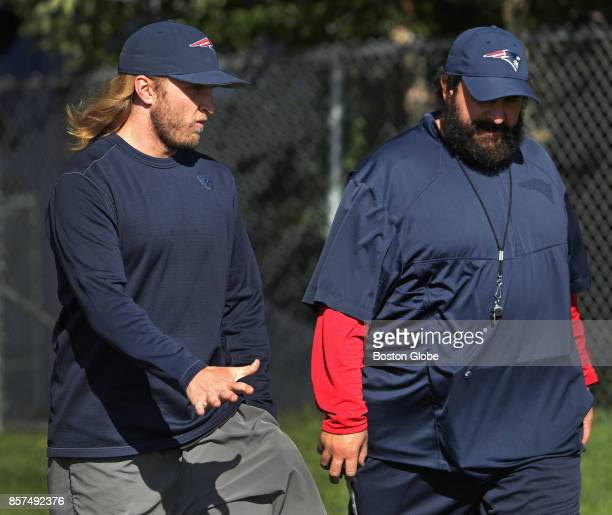New England Patriots defensive backs coach Steve Belichick left speaks with defensive coordinator Matt Patricia right during practice at Gillette...