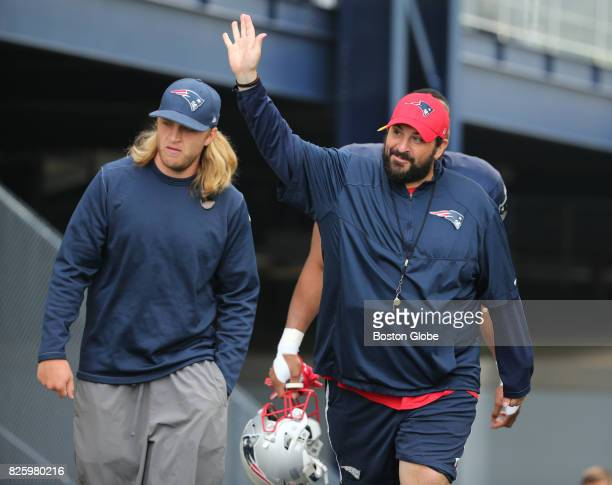 New England Patriots defensive coordinator Matt Patricia right and safeties coach Steve Belichick left walk onto the practice field during training...