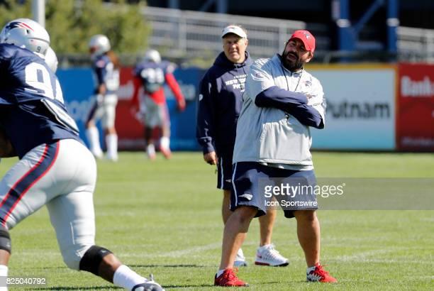 New England Patriots defensive coordinator Matt Patricia watches a drill as New England Patriots head coach Bill Belichick looks on during New...