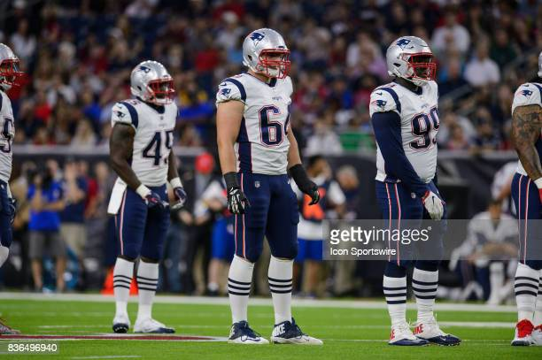 New England Patriots defensive end Caleb Kidder and New England Patriots nose tackle Vincent Valentine get ready for a play during the NFL preseason...