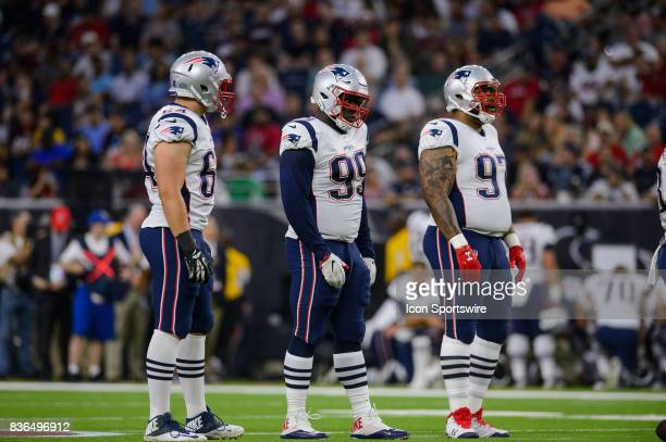 New England Patriots defensive end Caleb Kidder nose tackle Vincent Valentine and defensive end Alan Branch get ready for a play during the NFL...