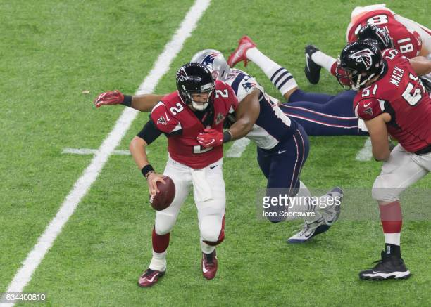New England Patriots defensive end Trey Flowers reaches out to tackle Atlanta Falcons quarterback Matt Ryan during the Super Bowl LI between the New...