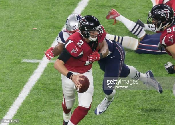 New England Patriots defensive end Trey Flowers tackles Atlanta Falcons quarterback Matt Ryan during the Super Bowl LI between the New England...