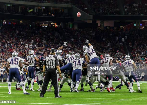 New England Patriots defensive line attempt to block a Houston Texans field goal during the NFL preseason game between the New England Patriots and...