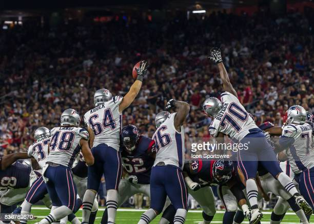 New England Patriots defensive line attempts to block a Houston Texans field goal during the NFL preseason game between the New England Patriots and...