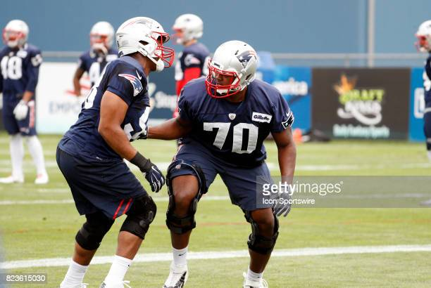 New England Patriots defensive lineman Adam Butler keeps tabs on New England Patriots defensive lineman Trey Flowers during New England Patriots...