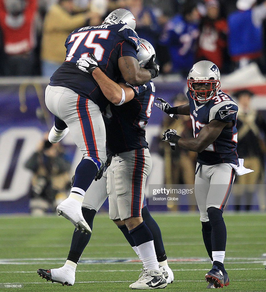 New England Patriots defensive tackle Vince Wilfork (#75) leaps into the arms of New England Patriots defensive end Rob Ninkovich (#50) after Ninkovich's interception of a Schaub pass in the third quarter as the New England Patriots hosted the Houston Texans in an NFL AFC Divisional Playoff Game at Gillette Stadium, Jan. 13, 2013.