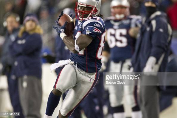 New England Patriots Deion Branch hauls in a 61yard touchdown reception against the Denver Broncos during 2nd quarter action in the AFC Divisional...