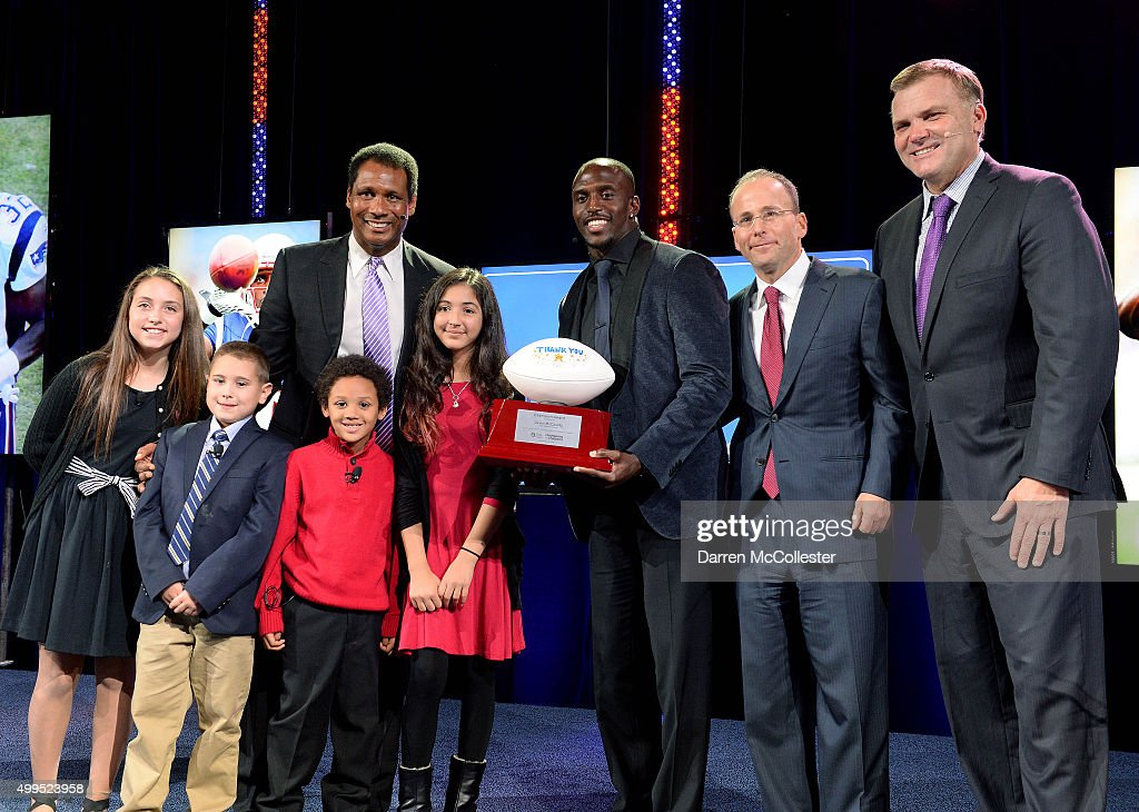 New England Patriots <a gi-track='captionPersonalityLinkClicked' href=/galleries/search?phrase=Devin+McCourty&family=editorial&specificpeople=4510365 ng-click='$event.stopPropagation()'>Devin McCourty</a> (C) receives the Champion Award at Champions For Children's benefitting Boston Children's Hospital at the Seaport World Trade Center with (L to R) Jen, Jackson, Steve Burton, Kobe, Amita, <a gi-track='captionPersonalityLinkClicked' href=/galleries/search?phrase=Jonathan+Kraft&family=editorial&specificpeople=221125 ng-click='$event.stopPropagation()'>Jonathan Kraft</a>, and Scott Zolack December 1, 2015 in Boston, Massachusetts.