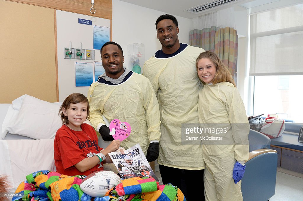 New England Patriot's <a gi-track='captionPersonalityLinkClicked' href=/galleries/search?phrase=Dion+Lewis+-+American+Football+Player&family=editorial&specificpeople=11433697 ng-click='$event.stopPropagation()'>Dion Lewis</a> (L), <a gi-track='captionPersonalityLinkClicked' href=/galleries/search?phrase=Geneo+Grissom&family=editorial&specificpeople=8606135 ng-click='$event.stopPropagation()'>Geneo Grissom</a>, and wife Haley visit Camryn at Boston Children's Hospital February 10, 2016 in Boston, Massachusetts.