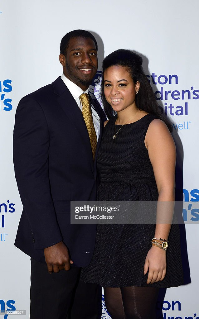 New England Patriots <a gi-track='captionPersonalityLinkClicked' href=/galleries/search?phrase=Duron+Harmon&family=editorial&specificpeople=8142142 ng-click='$event.stopPropagation()'>Duron Harmon</a> and Christine Sanchez attend Champions for Children's at Seaport World Trade Center on December 3, 2013 in Boston, Massachusetts.