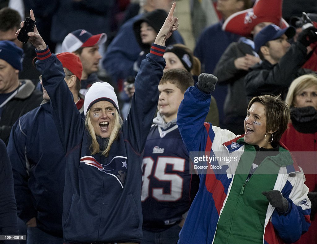 New England Patriots fans celebrate a touchdown against the Houston Texans during fourth quarter action as the New England Patriots hosted the Houston Texans in an NFL AFC Divisional Playoff Game at Gillette Stadium, Jan. 13, 2013.
