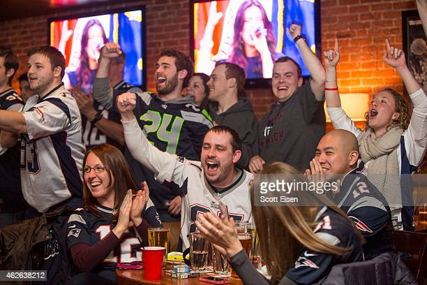 New England Patriots fans celebrate during the opening ceremony of Super Bowl XLIX at Jerry Remy's Sports Bar February 1 2015 in Boston Massachusetts...