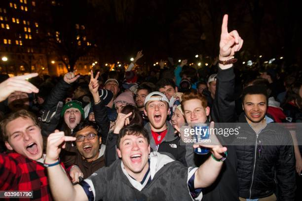 New England Patriots fans celebrate the Patriots Super Bowl victory against the Atlanta Falcons in the Boston Public Garden February 5 2017 in Boston...