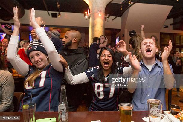 New England Patriots fans cheer after the Patriots took the lead in the fourth quarter in Super Bowl XLIX at Jerry Remy's Sports Bar February 1 2015...