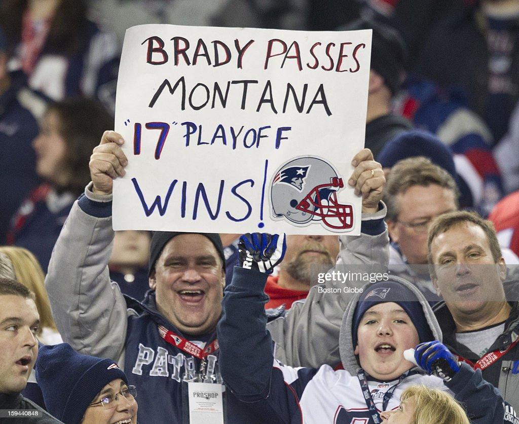 New England Patriots fans hold up a sign during the fourth quarter celebrating quarterback Tom Brady passing Joe Montana's record with 17 playoff wins, as the New England Patriots hosted the Houston Texans in an NFL AFC Divisional Playoff Game at Gillette Stadium, Jan. 13, 2013.