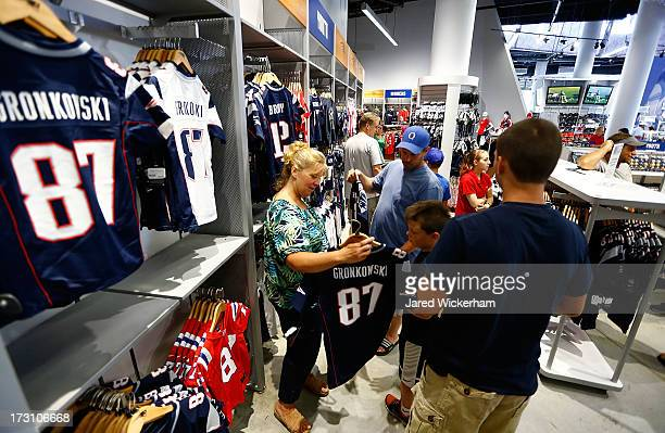 New England Patriots fans trade in their Aaron Hernandez jerseys during a free exchange at the pro shop at Gillette Stadium on July 7 2013 in Foxboro...