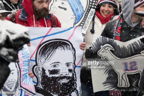 New England Patriots fans with a sketch of Julian Edelman at Copely Square during the Victory Parade through the streets of Boston on February 7 in...