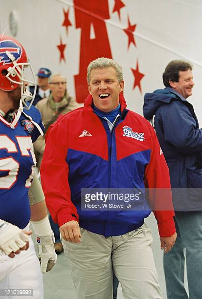 New England Patriots football coach Bill Parcells shares a joke while patrolling the sidelines at Foxboro Stadium Foxboro MA October 1994