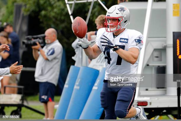 New England Patriots fullback Glenn Gronkowski eyes a catch during Patriots training camp on August 3 at Gillette Stadium in Foxborough Massachusetts