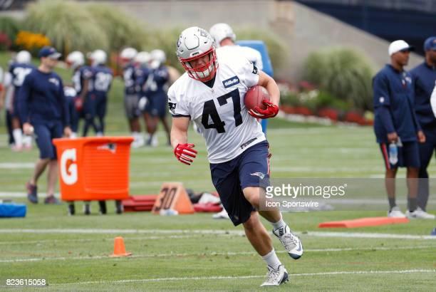 New England Patriots fullback Glenn Gronkowski runs with the ball during New England Patriots training camp on July 27 at the Patriots Practice...