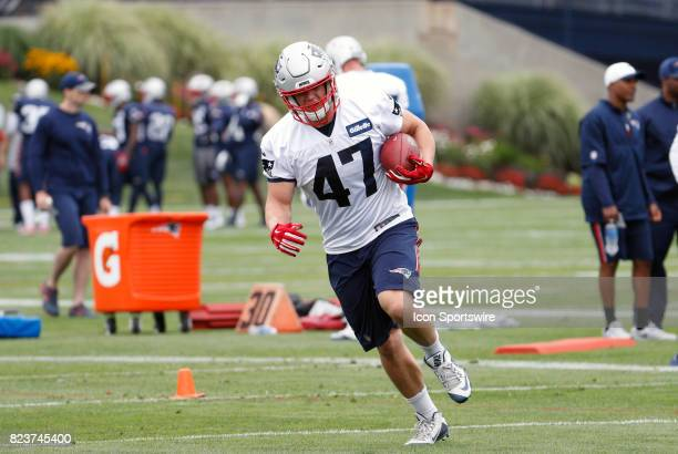 New England Patriots fullback Glenn Gronkowski runs with the ball during New England Patriots training camp on July 27 at the Patriots Practice...