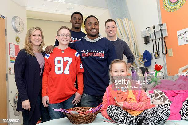 New England Patriot's Geneo Grissom and Dion Lewis visit Ella brother Matt Mom and Dad at Boston Children's Hospital February 10 2016 in Boston...