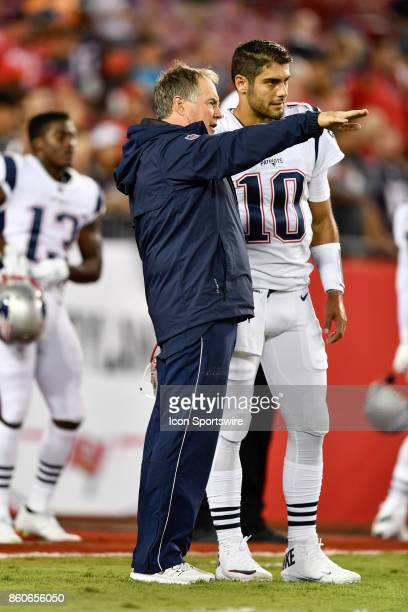 New England Patriots head Bill Belichick speaks to New England Patriots quarterback Jimmy Garoppolo prior to an NFL football game between the New...