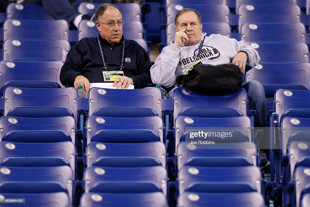 New England Patriots head coach Bill Belichick and friend Vinnie Colelli look on during the 2015 NFL Scouting Combine at Lucas Oil Stadium on...