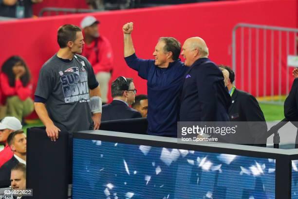 New England Patriots head coach Bill Belichick celebrates on the podium with New England Patriots quarterback Tom Brady after Super Bowl LI on...