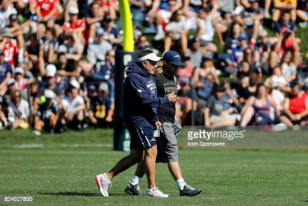 New England Patriots head coach Bill Belichick chats with New England Patriots safeties coach Steve Belichick during New England Patriots training...