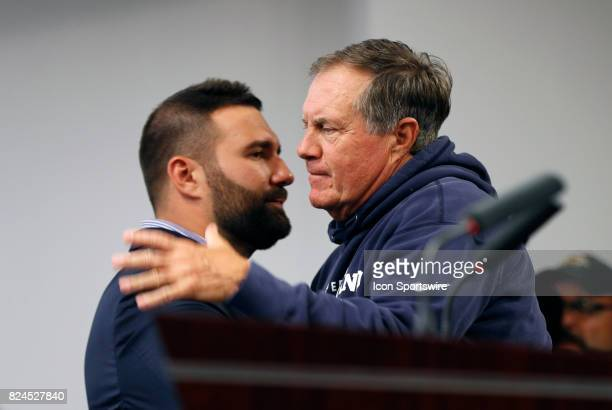 New England Patriots head coach Bill Belichick hugs New England Patriots defensive end Rob Ninkovich after introducing him during his retirement...