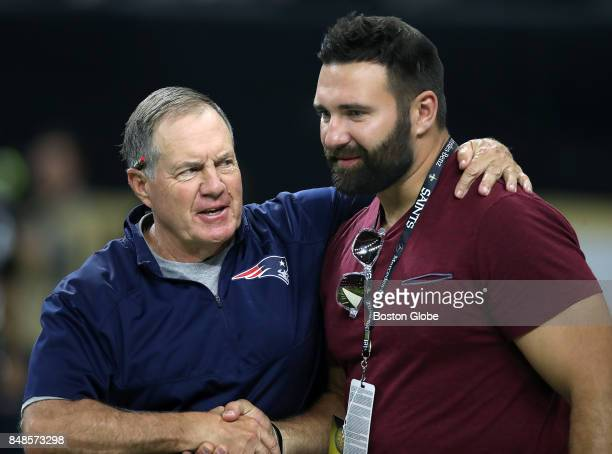 New England Patriots head coach Bill Belichick left gives a handshake to retired defender Rob Ninkovich right before the start of a game against the...