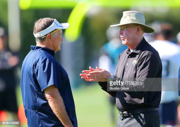 New England Patriots head coach Bill Belichick left talks to Jacksonville Jaguars head coach Tom Coughlin during a joint training camp at Gillette...