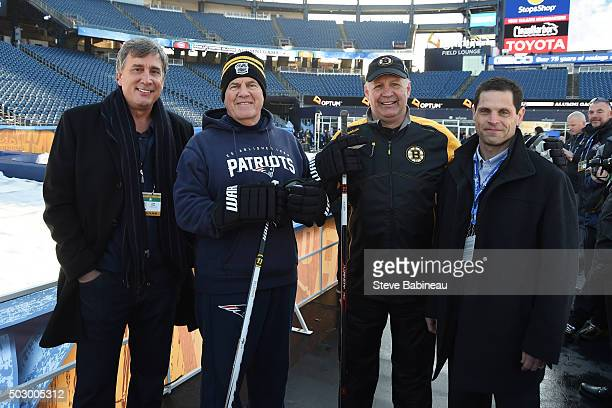 New England Patriots head coach Bill Belichick poses with Boston Bruins president Cam Neely head coach Claude Julien and general manager Don Sweeny...